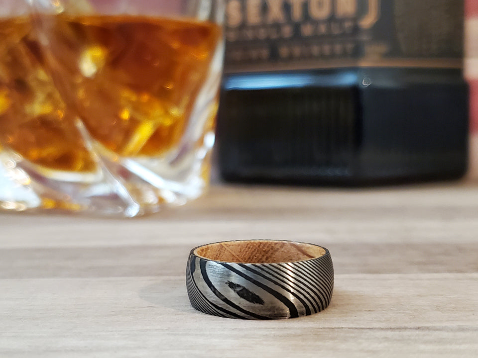 Mens Black Damascus Steel with Whiskey Barrel Wood Sleeve Wedding Band Ring