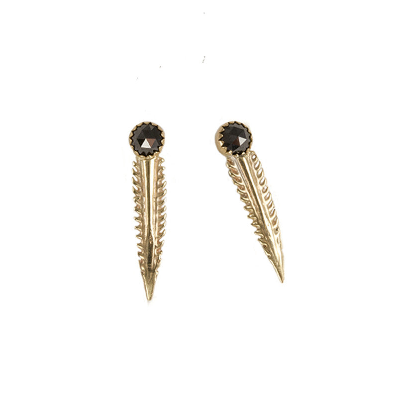 barb tip studs with cabochon stone