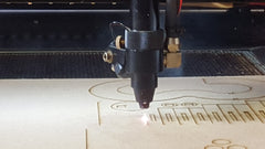 MAD Museum laser cutting