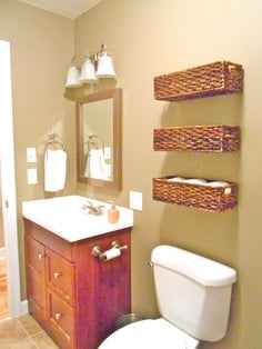 Decorative storage above the toilet Bathroom Storage In-Style with Willow Baskets