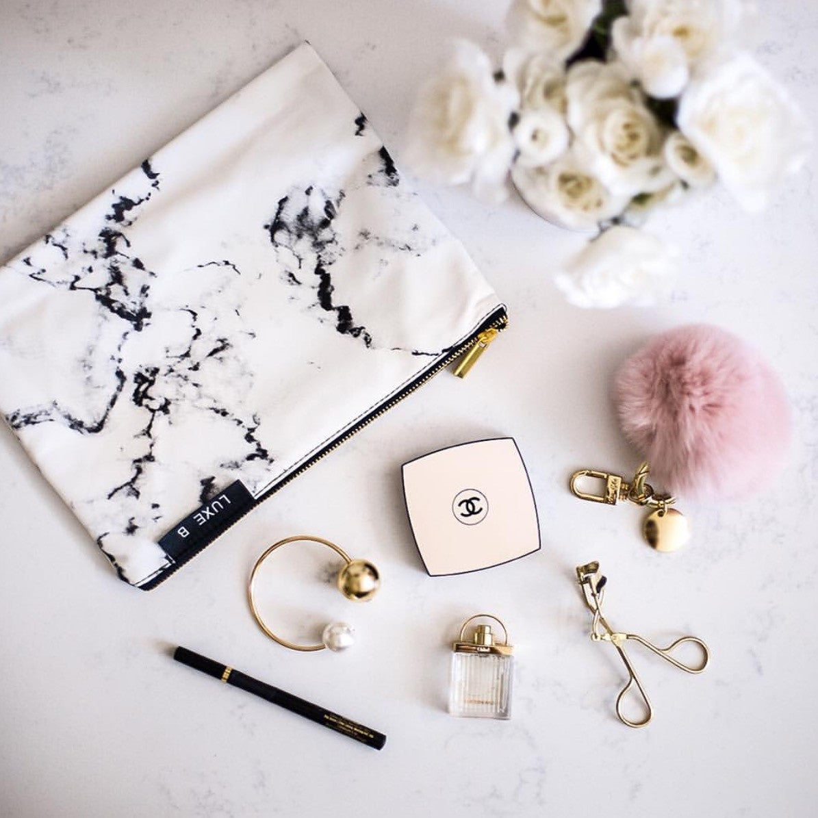 Marble Cosmetic Bag Flat Lay with chanel makeup