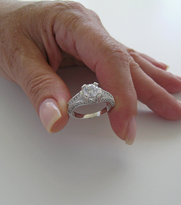 ENGAGEMENT RING SETTING WITH DIAMOND AND MIL GRAIN DETAILS