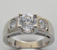 THREE STONE RING SETTING DESIGN WITH DIAMOND SIDE ACCENTS FOR A 1.00 CARAT ROUND DIAMOND
