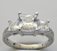 Three Stone Engagement Ring Setting for a Princess Cut 6.25 x 6.25 mm