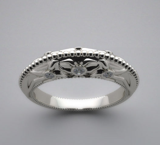 Floral motif wedding ring band accented with diamonds