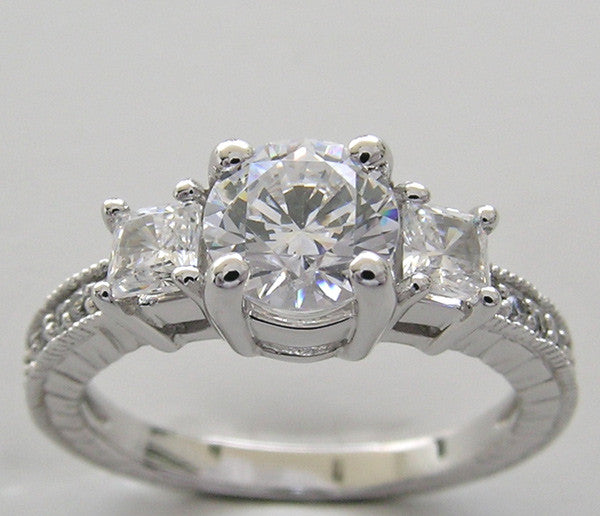 PRINCESS AND ROUND CUT DIAMOND RING SETTING SHOWN WITH A ROUND DIAMOND