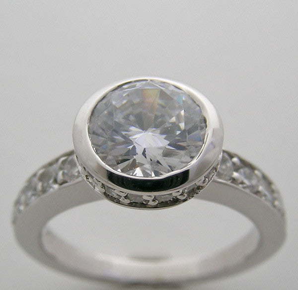 BEZEL ENGAGEMENT RING SETTING WITH DIAMOND ACCENTS