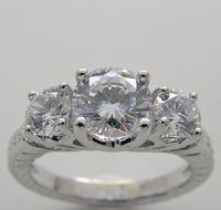 THREE STONE ANNIVERSARY DIAMOND ENGAGEMENT RING SETTING SHOWN WITH A 6.50 MM CENTER DIAMOND