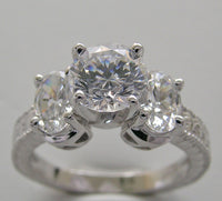ROUND AND OVAL SHAPE THREE STONE RING SETTING