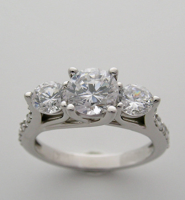 THREE STONE DIAMOND ENGAGEMENT RING SHOWN WITH A 1.00 CT ROUND DIAMOND
