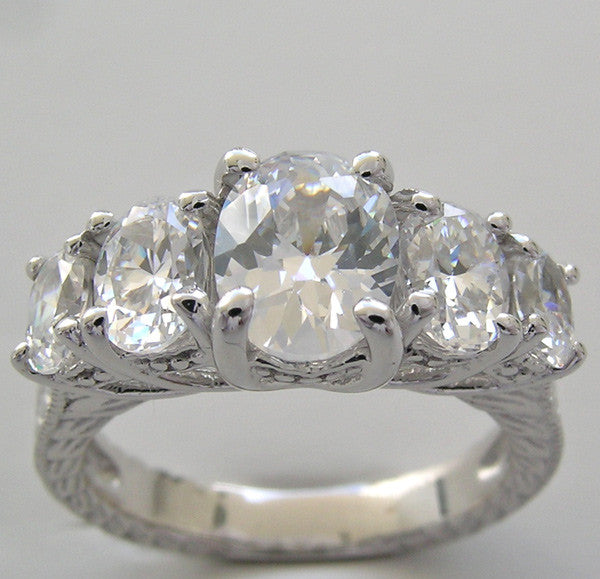 Five Stone Ring Setting to accomodate a 8.00 x 6.00 mm center Oval