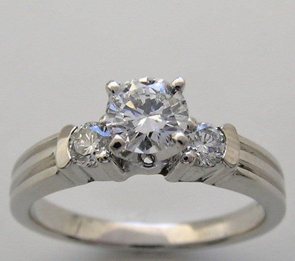 THREE STONE DIAMOND ENGAGEMENT RING SETTING SHOWN WITH A 4.80 MM DIAMOND