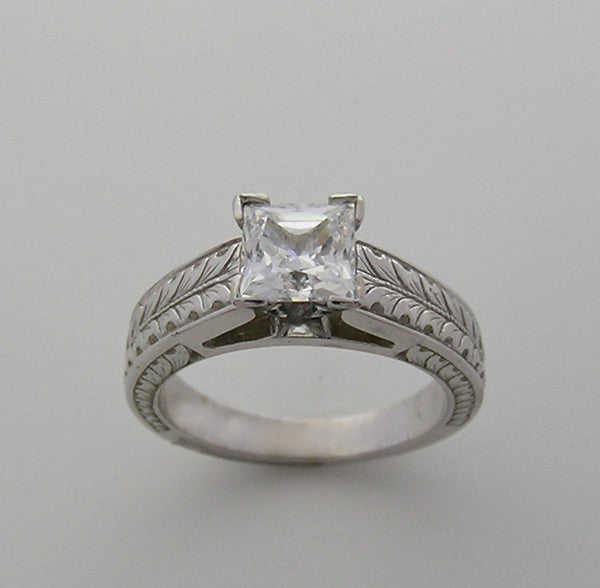 RING SETTING WITH LEAF PATTERN SHOWN WITH A PRINCESS CUT DIAMOND 6.00 X 6.00 MM GEMSTONE
