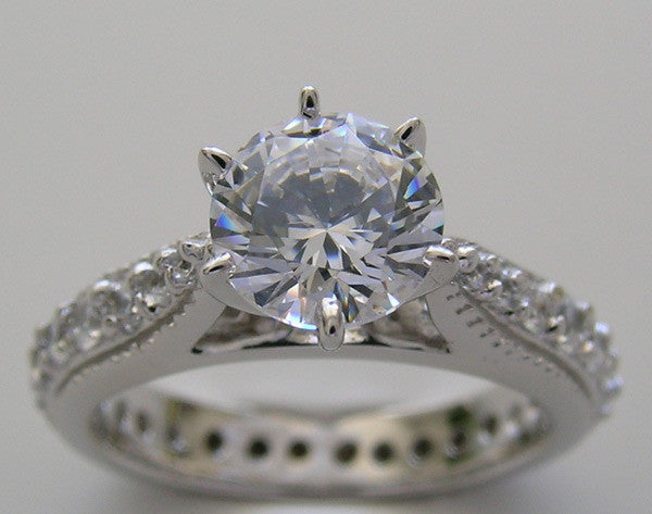 TRADITIONAL ENGAGEMENT RING WITH DIAMOND ETERNITY SHANK