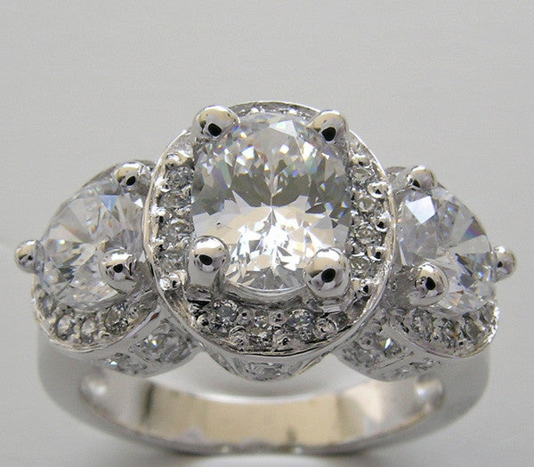 Three Diamond Stone Ring Setting Center Oval 8.00 x 6.00mm and 2 round Stones 5.5 mm