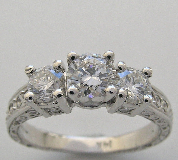 THREE STONE DIAMOND RING SETTING SHOWN WITH A 0.40 CT CENTER DIAMOND
