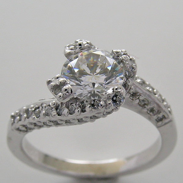 UNUSUAL ENTWINNED SWIRL DESIGN SOLITAIRE RTING SETTING WITH DIAMOND ACCENTS
