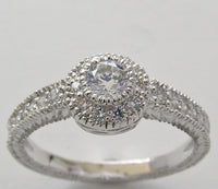 ENGAGEMENT DIAMOND RING SETTING FOR A ROUND DIAMOND