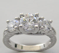 There Stone Engagement Ring Settings for a 6.5 mm and 2 x 5.00 mm Diamonds