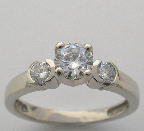 THREE STONE DIAMOND ENGAGEMENT RING SETTING SHOWN WITH A 4.70 MM DIAMOND