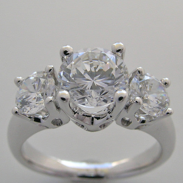 THREE STONE ANNIVERSARY DIAMOND ENGAGEMENT RING SETTING SHOWN WITH A 7.00  MM CENTER DIAMOND