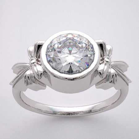 BOW DESIGN RING SETTING FOR A 6.5 MM ROUND GEMSTONE