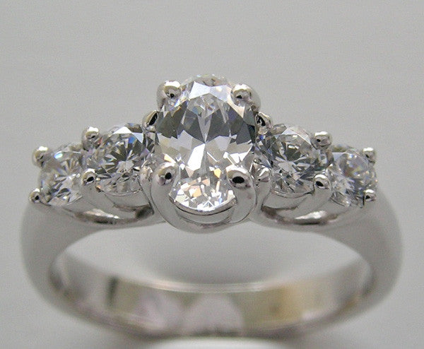 Five tone Ring Setting with a center oval 8.00 x 6.00 mm and 4 round diamonds