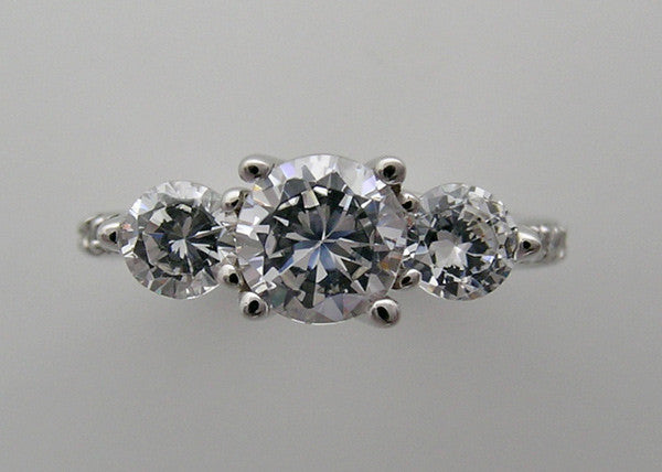 FEMININE THREE STONE DIAMOND RING SETTING