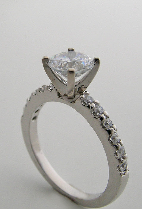 ENGAGEMENT RING SETTING WITH FEMININE DIAMOND ACCENTS