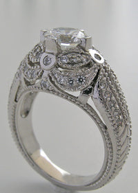 IMPORTANT DIAMOND ACCENTED ENGAGEMENT RING SETTING OR RE-MOUNT RING SETTING