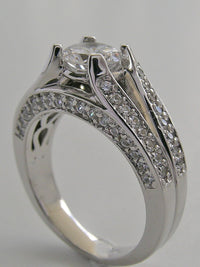 SPLIT SHANK DIAMOND ENGAGEMENT RING SETTING SHOWN FOR  ROUND STONE