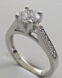 HIGH SET ENGAGEMENT RING SETTING WITH DIAMOND ACCENTS