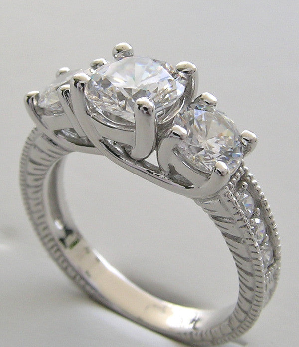 FEMININE ROUND THREE STONE ENGAGEMENT RING SETTING WITH DIAMOND ACCENTS
