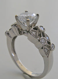 RING SETTING  MIL GRAIN DIAMOND ACCENT TO FIT ANY SHAPE AND SIZE GEMSTONE