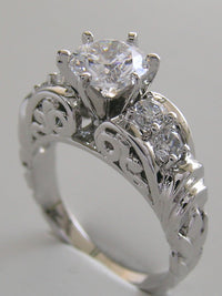 PLATINUM OR GOLD DIAMOND ACCENTED ENGAGEMENT RING SETTING