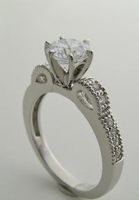 FEMININE DIAMOND ENGAGEMENT RING SETTING WITH STYLIZED BOW DESIGN