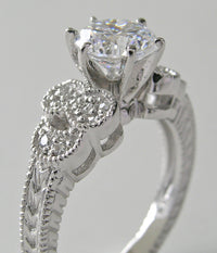 DIAMOND RING SETTING WITH FEMININE FLORAL ACCENTS AND MIL GRAIN DESIGN