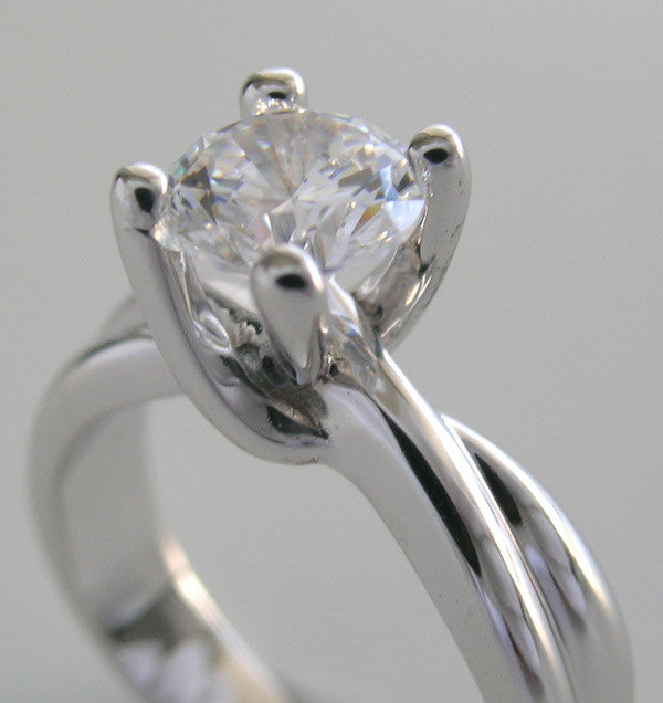 SOLITAIRE ENGAGEMENT RING SETTING WITH INTEREST DESIGN