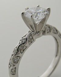 INTERESTING ENGAGEMENT RING SETTING FEMININE DIAMOND DETAILS