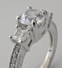 PRINCESS AND ROUND CUT DIAMOND RING SETTING