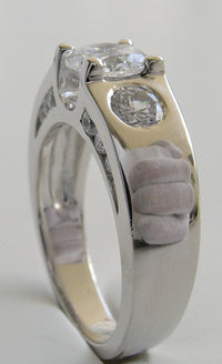 UNUSUAL THREE STONE RING SETTING DESIGN WITH DIAMOND SIDE ACCENTS