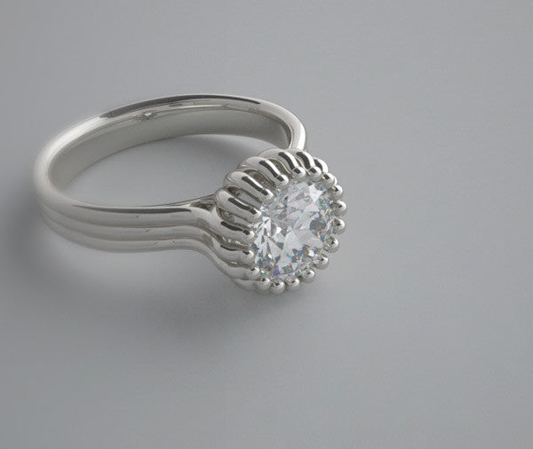 INTERESTING SOLITAIRE RING SETTING MULTI PRONG DESIGN