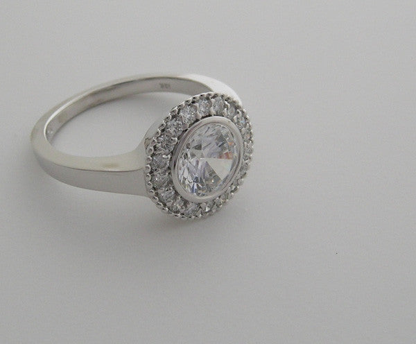ENGAGEMENT RING SETTING WITH HALO VINTAGE STYLING AND MIL GRAIN DETAILS