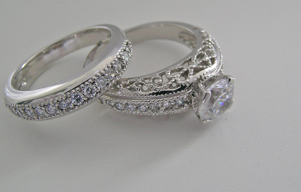 IMPORTANT DIAMOND ACCENT ENGAGEMENT RING AND DIAMOND WEDDING BAND SETTING SET
