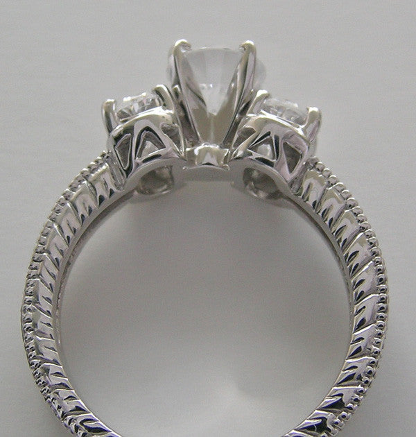 UNIQUE ROUND AND OVAL SHAPE THREE STONE RING SETTING