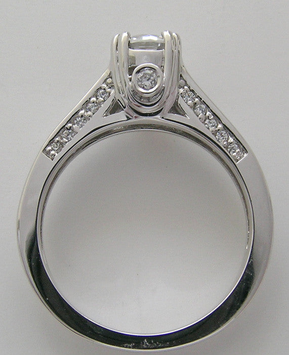INTERESTING ENGAGEMENT RING SETTING WITH DIAMOND PEEK A BOO ACCENTS