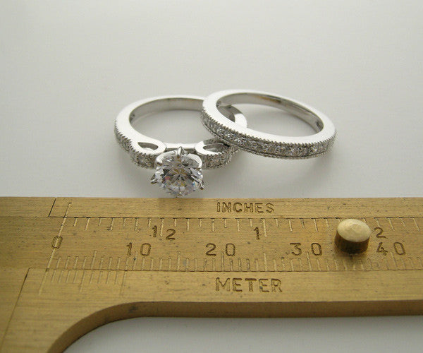 FEMININE  RIBBON DESIGN DIAMOND BRIDAL RING SETTING SET WITH MIL GRAIN