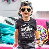 Hustler Tee - MootsClothing, Funny, moots, kids fashion, cool kids clothes, mom life, motherhood, wine, baby clothes, children's clothes, childrens clothing, babies clothing, toddler clothing, you're my person, fashion, women's fashion, funny kids tee, mom, gift, toddler fashion, mother, parenthood, funny t shirts, funny shirts, funny shirt, coffee, humor, java, funny, caffeine, coffee jokes, coffee lover gifts, coffee t shirts, coffee shirts, kids shirts, toddler shirts, baby shirts, mom shirts, gifts for coffee lovers, gifts for wine lovers, wine shirts, coffee gifts, wine gifts, wine shirt, graphic tee,