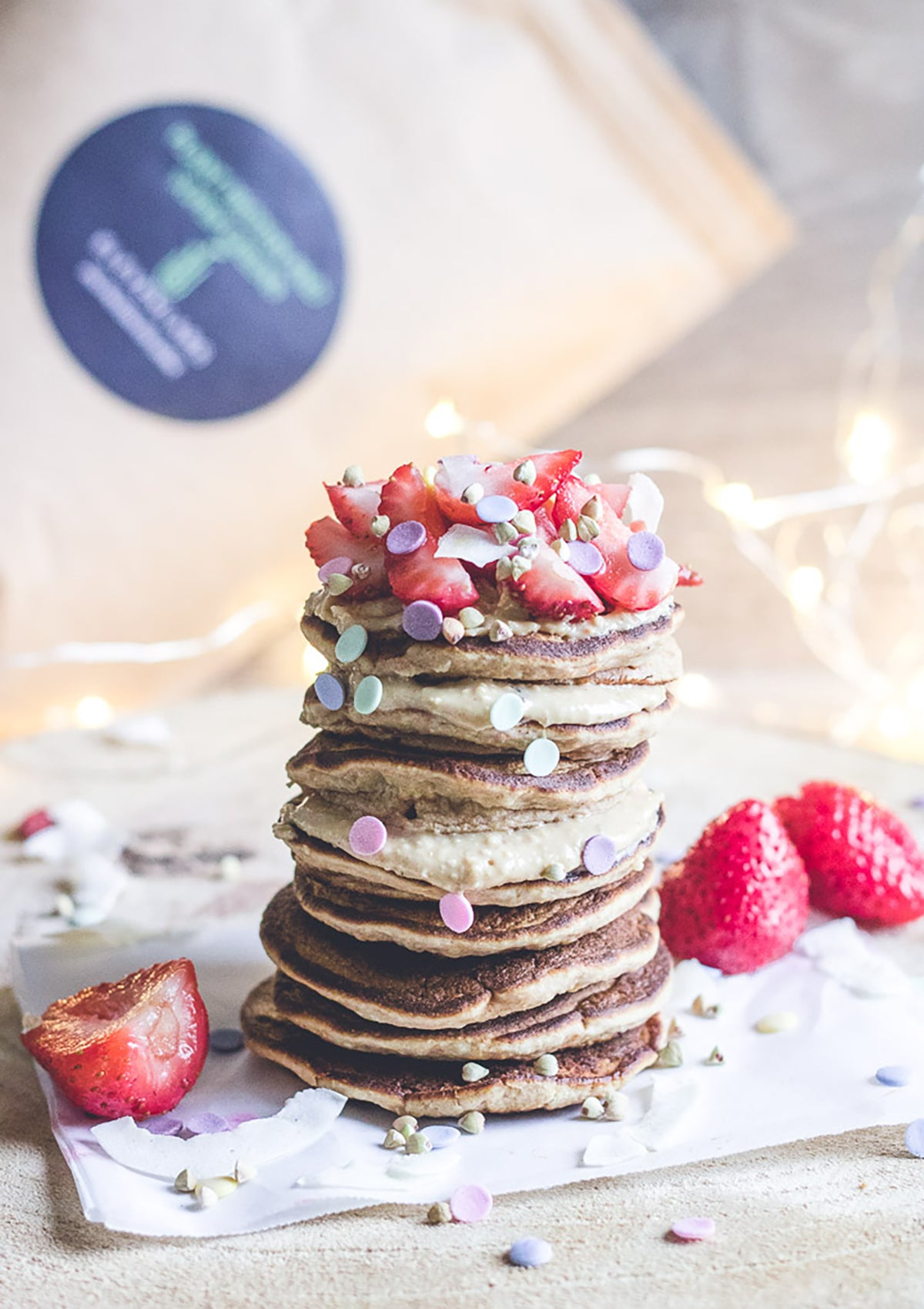elevenlabs nourishing plant protein pancakes stacked with cashew cream and strawberries