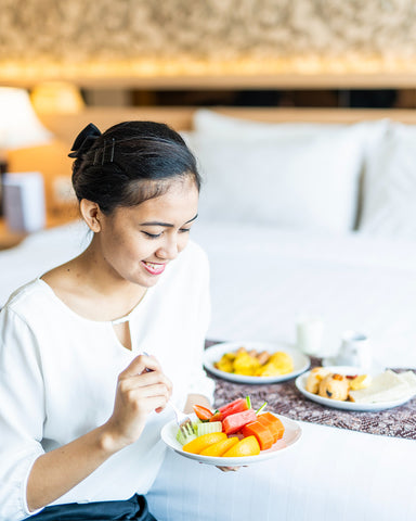 girl eating fresh fruit in a bowl